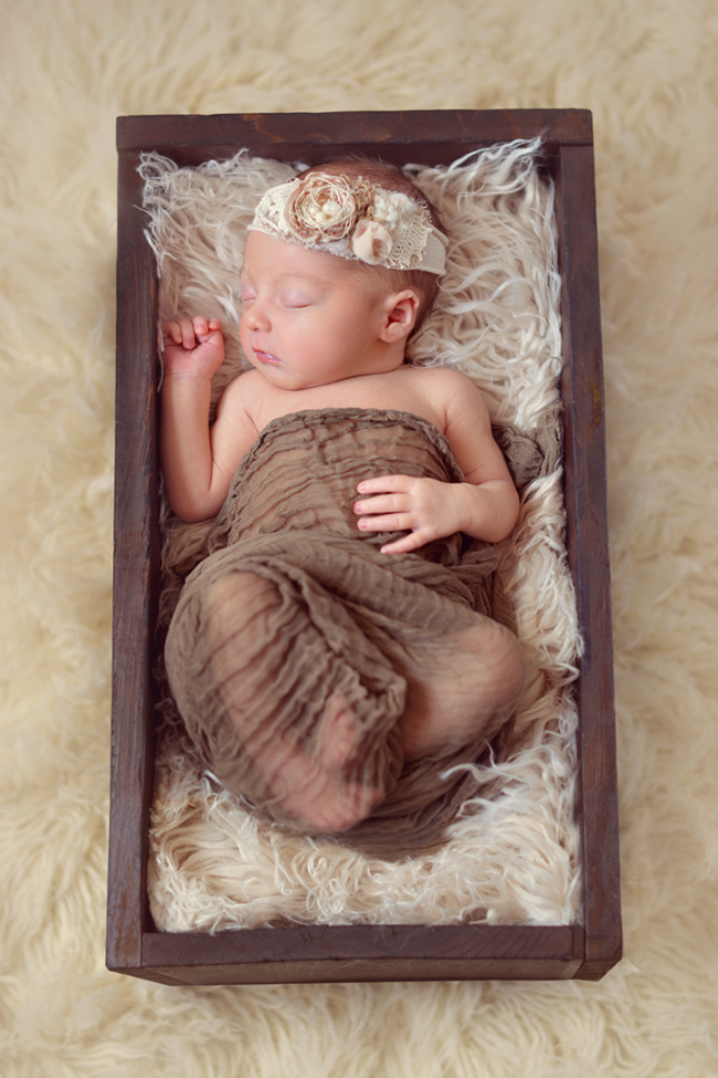 Baby girl in a box with a headband